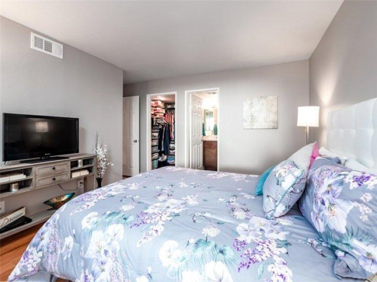Master Bedroom see into organized walk-in closet & peek into Bathroom