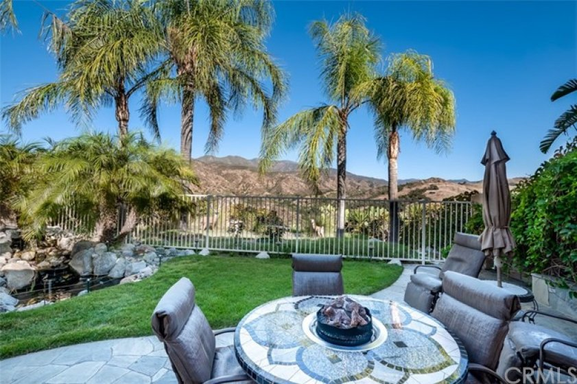 IMMACULATE YARD WITH CUSTOM KOI POND ...AND NEVER ENDING VIEWS
