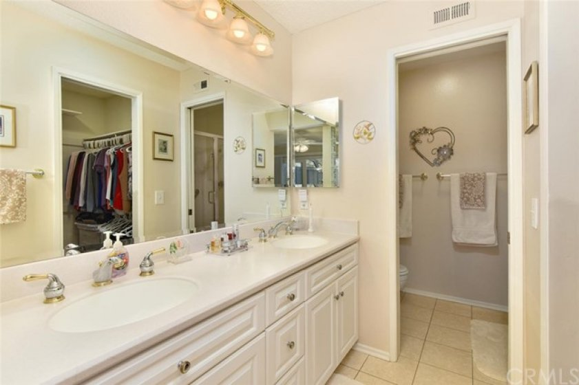 Double sinks, designer faucets, corian intergrated sinks.  Private water closet.