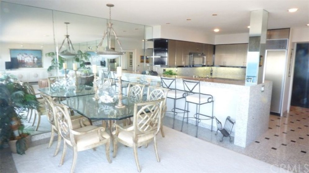 Dining room and open kitchen, mirrored walls enhance all views