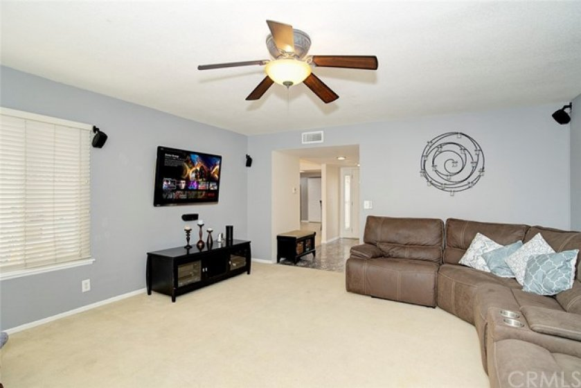 Living room with view of back yard and into foyer, entry and dining room