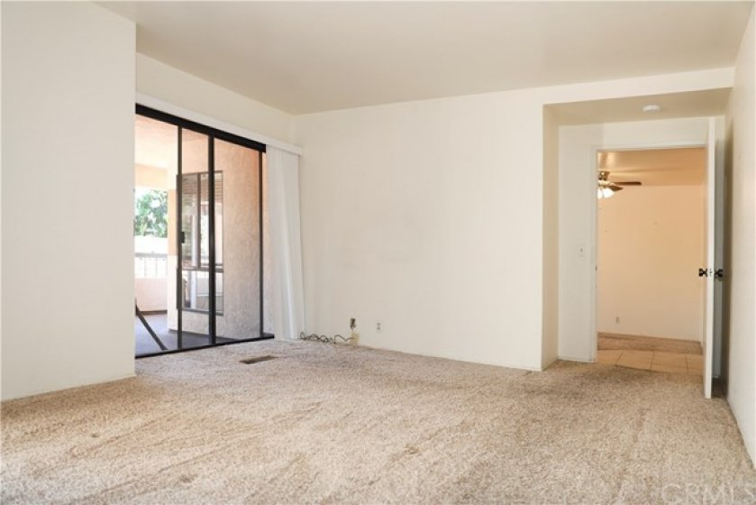 master bedroom with slider to patio