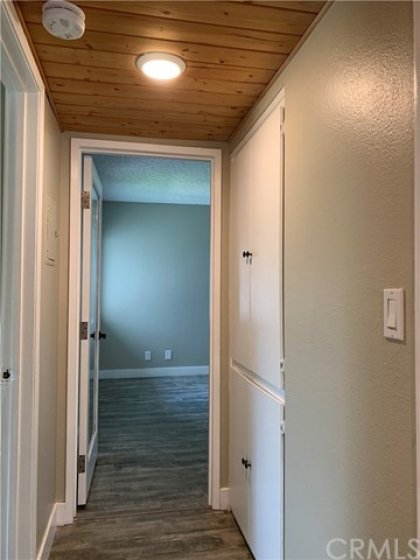 View from the hallway of the master bedroom and hallway storage