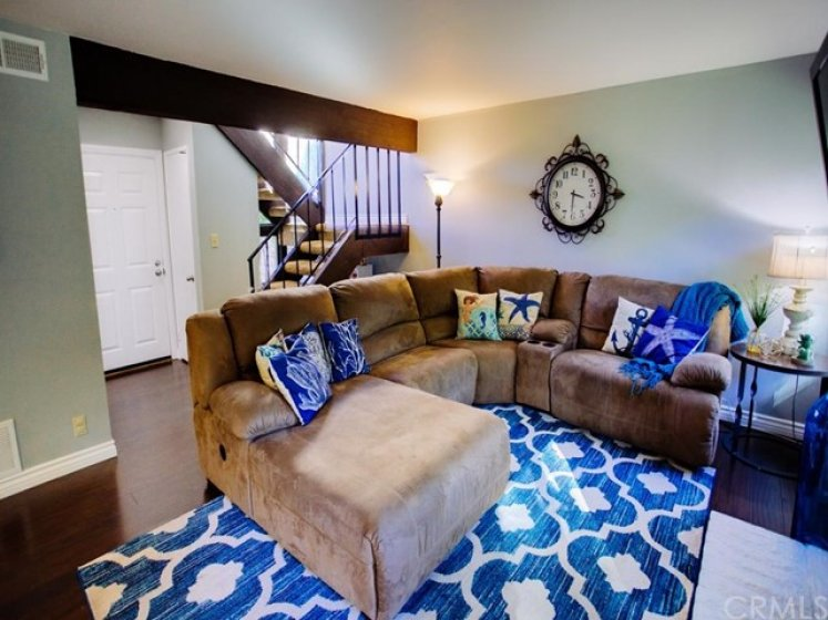View of living room and front door. Spacious enough to accommodate a sectional.