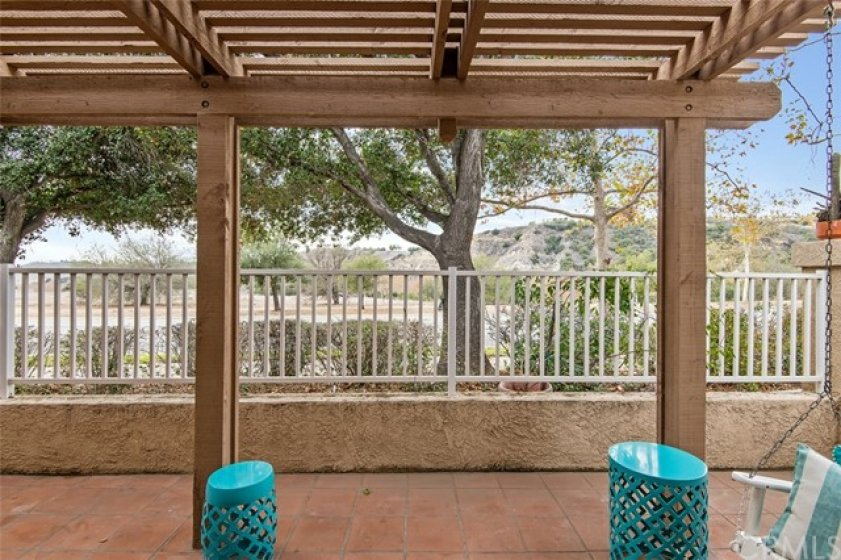 Freshly painted pergola and swing in the back patio a perfect place to enjoy your morning coffee and or view a beautiful sunset.