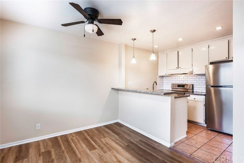 Open Concept kitchen featuring beautiful subway tile backsplash, granite countertops with stainless steal appliances in your new kitchen!