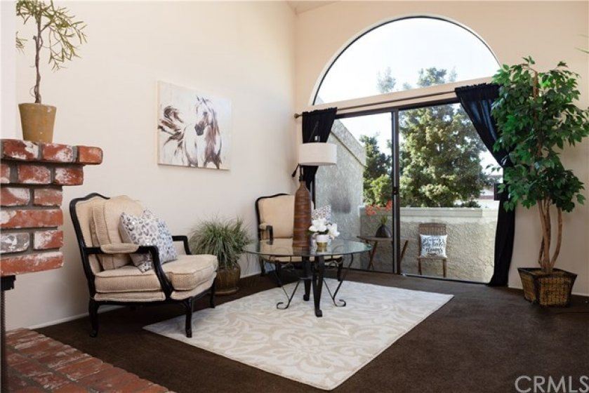 Living room has soaring ceilings, huge balcony and lots of natural light!