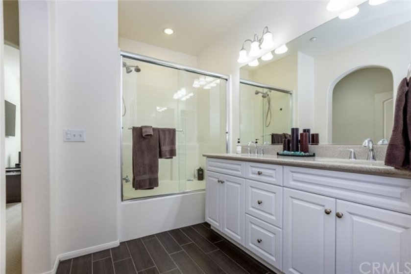 Two sink counter top in big master bathroom with private door to toilet and organized closet.