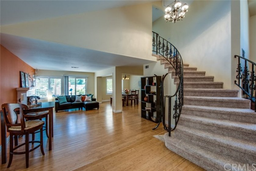 A look to the left of the entry to the family room with fireplace and dining room.