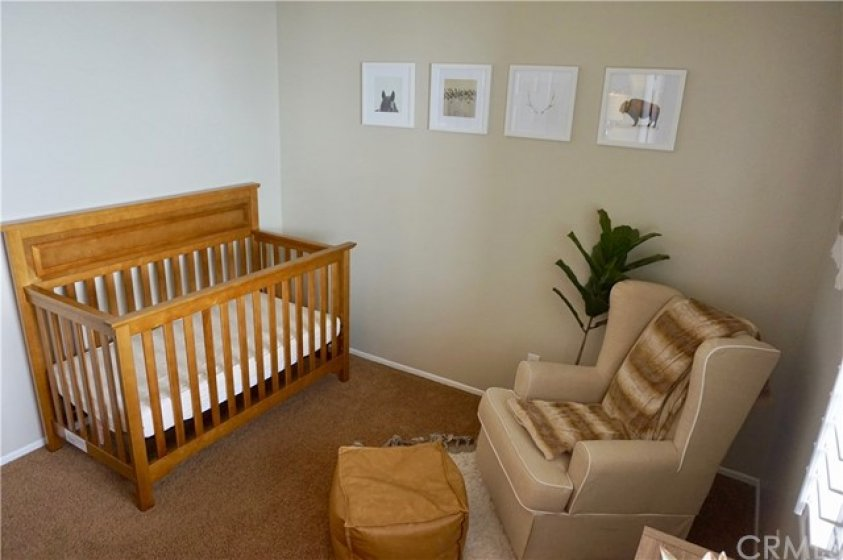 Bedroom #2 is perfect size for the little ones!  This room also has a built-in shelving in the closet.