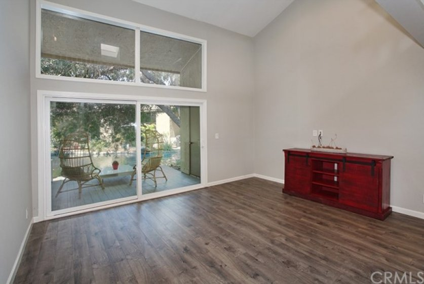 The 10ft. Milgard sliding glass door is dual-paned with an attached screen. Both windows and slider have been trimmed out with moulding.