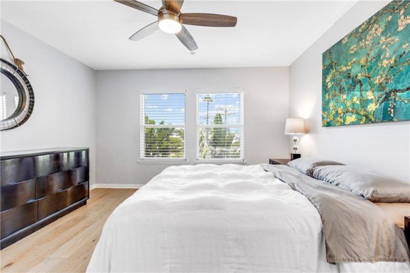 Primary bedroom with ceiling fan