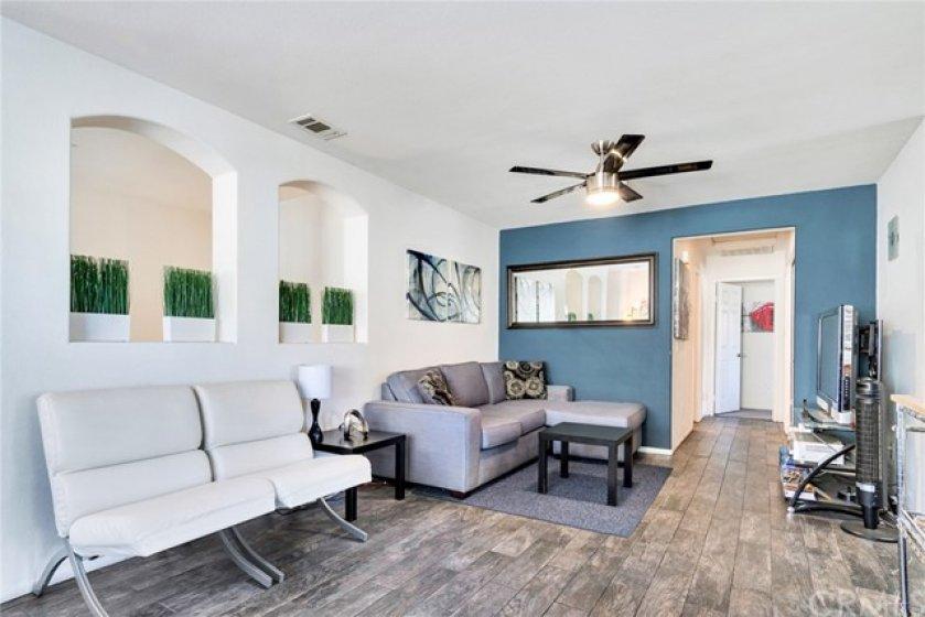 Wood-like Tile flooring and custom painted walls.