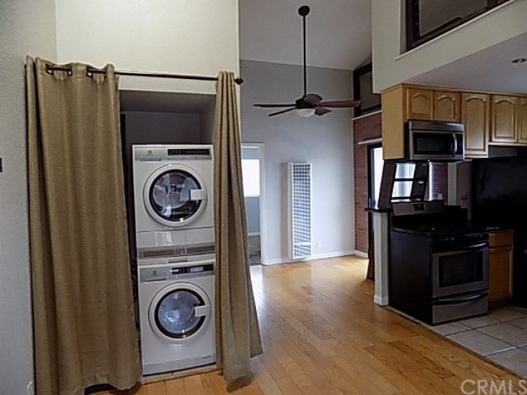 Closet that holds stacked washer/dryer