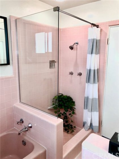 Charming, but completely functional stand up shower.