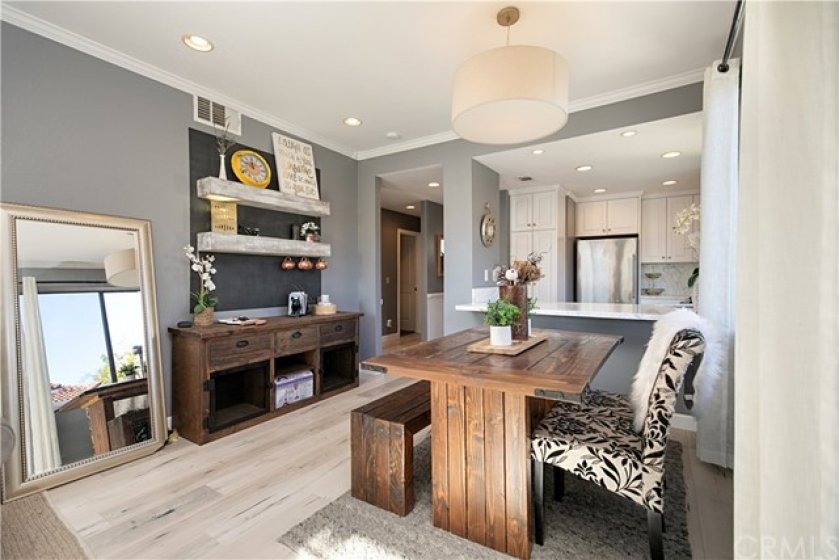 Open floor plan main living space offers newer floors, crown moulding, gas fire place, recessed lighting and more.