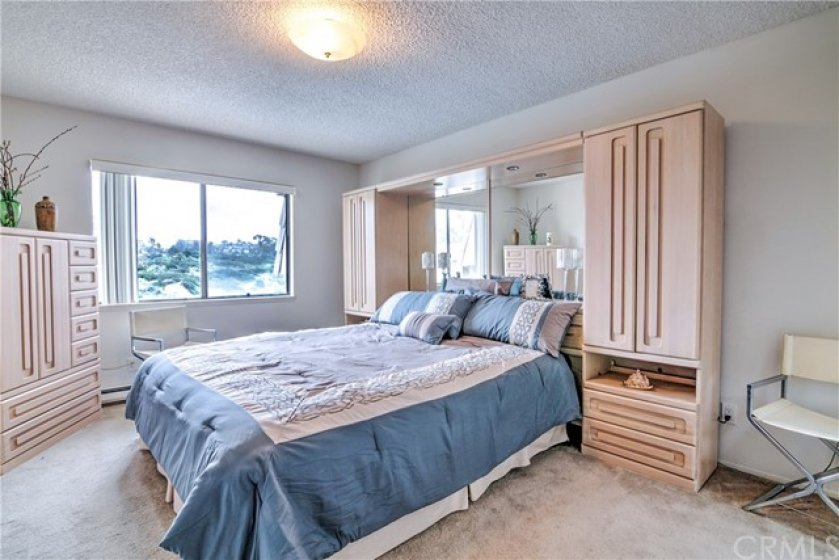Master bedroom has views of the surrounding hills, a private master bath and walk-in cedar lined closet