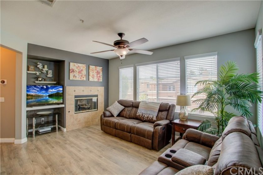 Bright with natural light living area featuring gas fireplace.