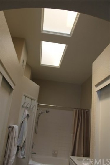 Both upstairs bathrooms have skylights. Not all units have this feature.