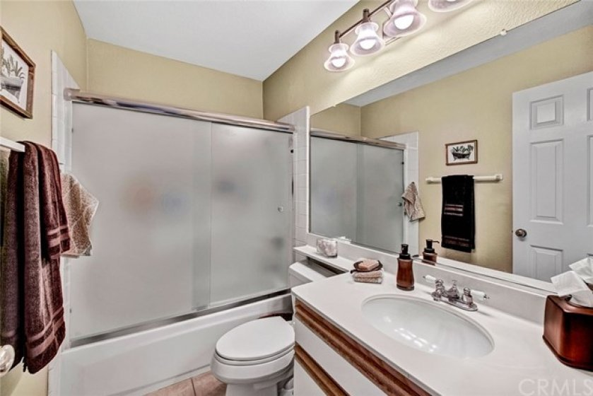 Guest bathroom includes bathtub/shower combo
