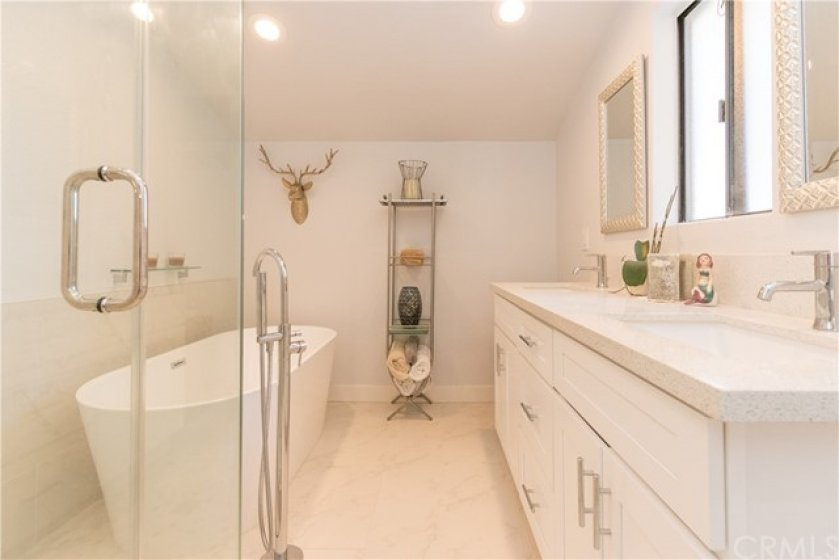 Luxurious master bath with dual vanity and separate bath and shower.