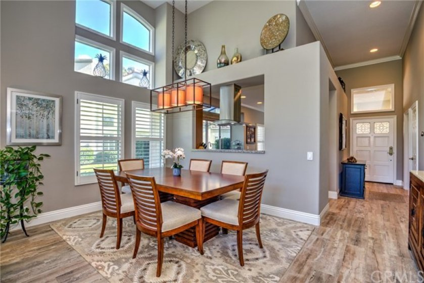 Formal Dining Room with Custom Light Fixture and Views of the Golf Course