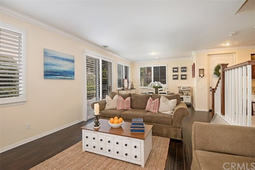 This angle of the living room shows the openness to the dining room