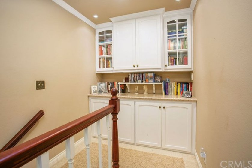 Incredible built-in at top of stairway.