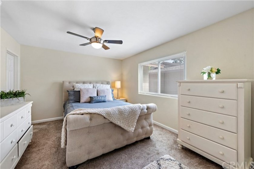 Master bedroom is generous in size with a wall to wall mirrored closet and private en suite.