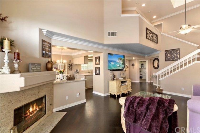 Fireplace with mantle along with granite facing and hearth- Gas logs and auto lighter- The wall that separates the dining room has matching granite top