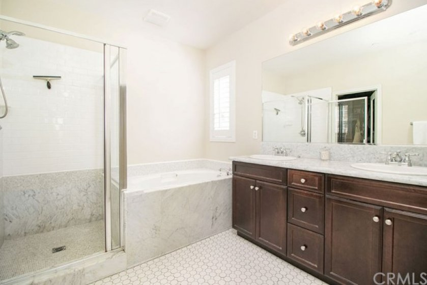 Upgraded tile and flooring in the master bathroom.