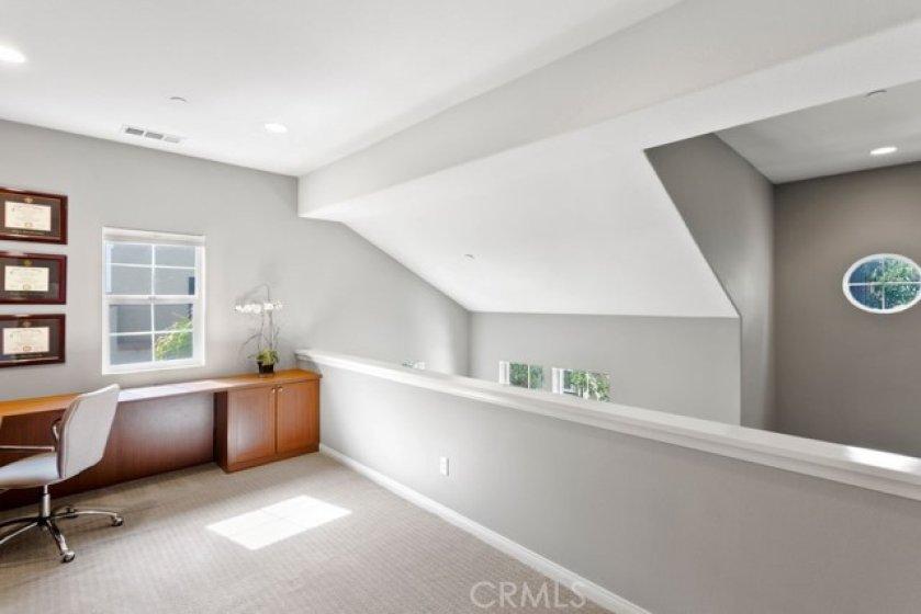 BONUS!! The loft area has a California Closet built in desk.