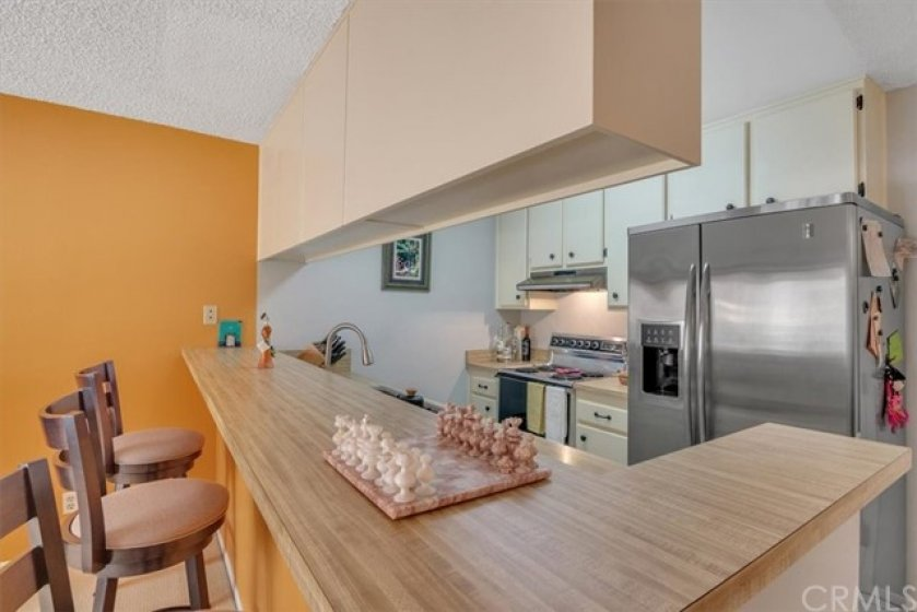 The Attractive Kitchen offers Breakfast Bar Dining and Stainless Steel Appliances.