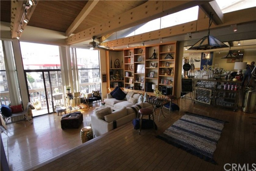 Extra wide 22' living room with vaulted ceiling and private waterfront balcony