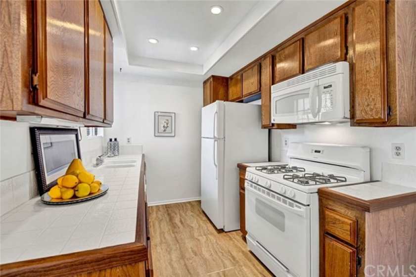 The refrigerator is included. Tile countertops give a fresh, clean look.