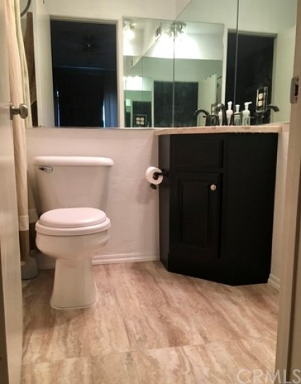 Master bathroom with new flooring and remodeled vanity