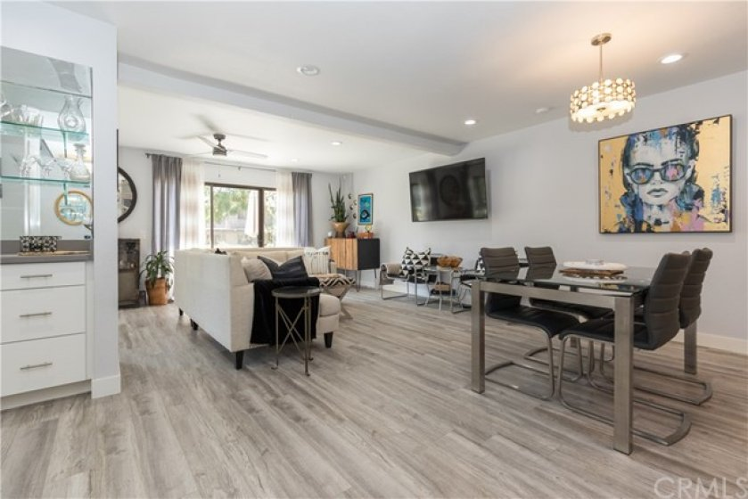 Breathtaking interior with beautiful flooring, spacious living and dining rooms, and a bar.