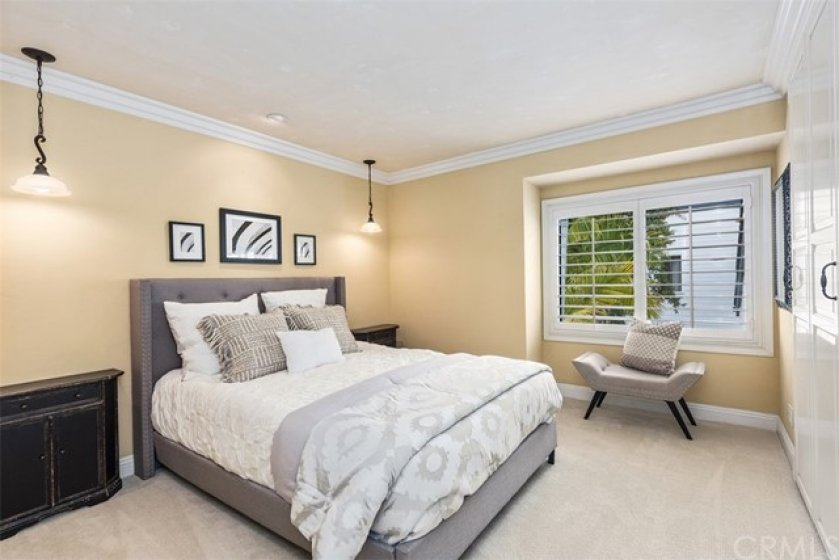 This second bedroom has it all soothing colors, great light, built-in wardrobe and ample space.