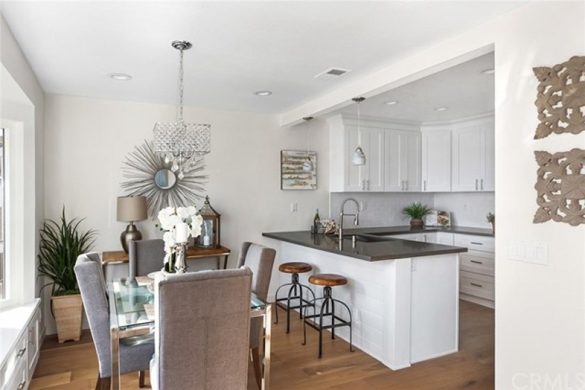 View of dinning room and gorgeously remodeled kitchen from the living room.