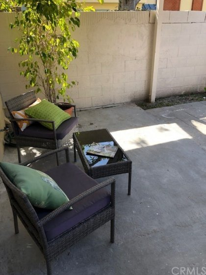Nice back patio to this condo for children or to take some sun&#x3B; family gatherings, etc.