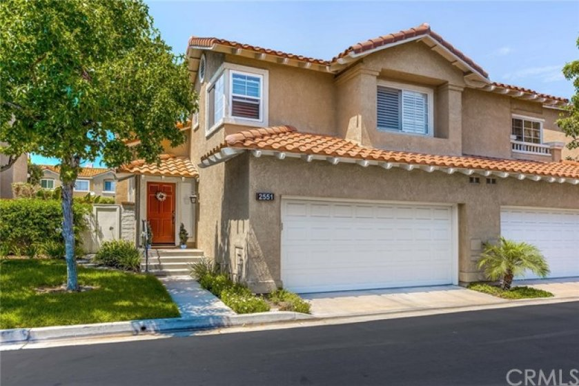Beautiful curb appeal with lush front lawn welcomes you home!