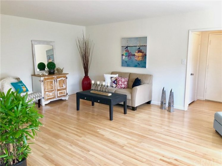 """The open floor plan with plenty of wall space allows for hanging art, and ZERO concern about """"what wall do I put the TV on"""", because there are plenty of options"""