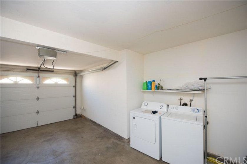 Garage with private laundry area.