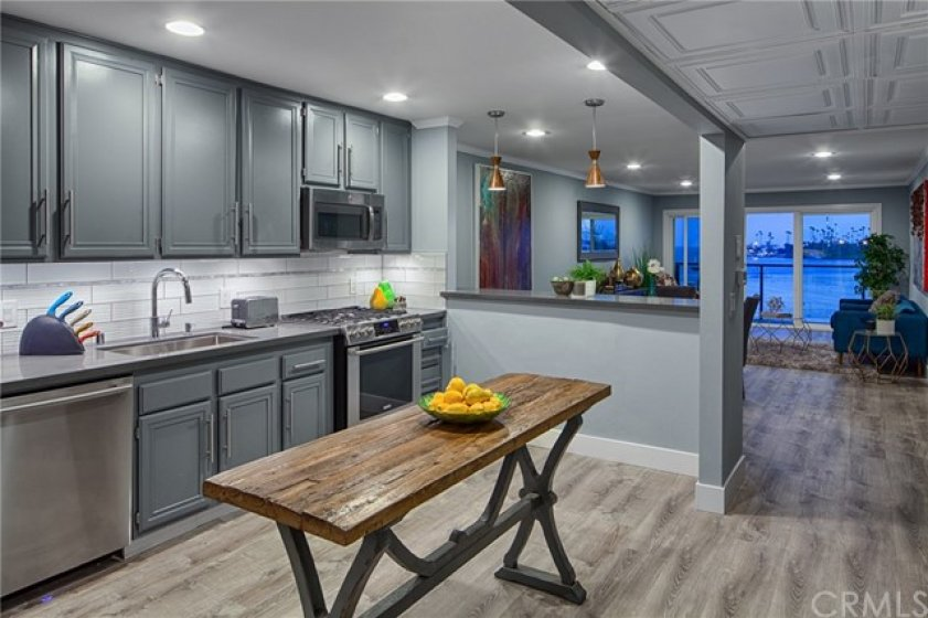 Kitchen is Updated and Spacious, offering Quartz Counters and High end Stainless Appliance Package.  New Waterproof Vinyl Plank throughout the entire unit.
