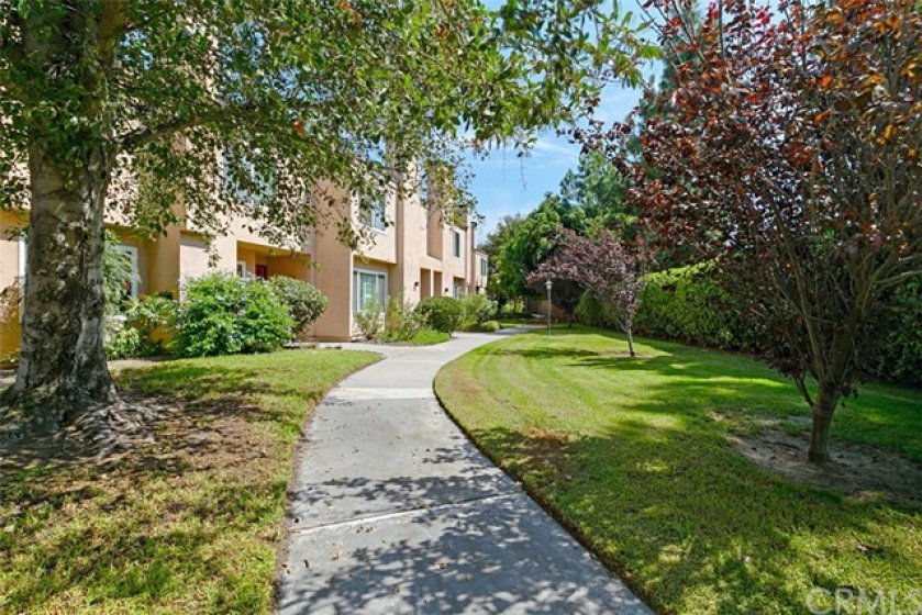 Meandering walkways with well cared for landscape throughout the complex
