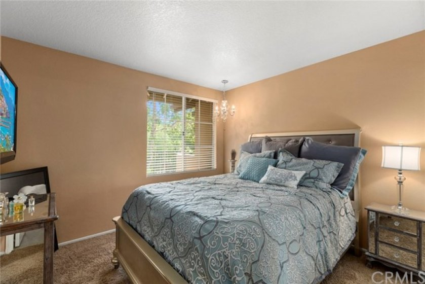 Guest bedroom upstairs- Carpeted- Window with blinds-