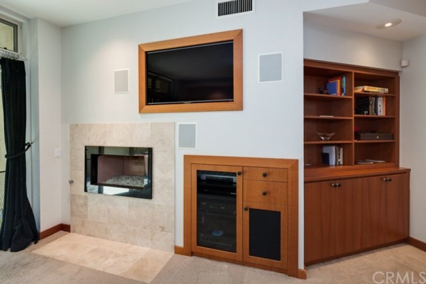 . . . Master features include a cozy fireplace, flat-screen TV and existing AV equipment . . .