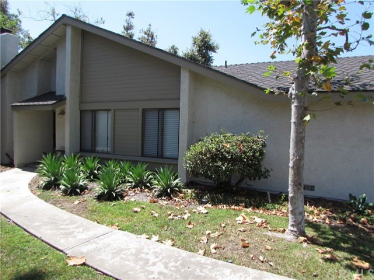 Lush drought tolerant landscaping, with green belt to enjoy! End unit!