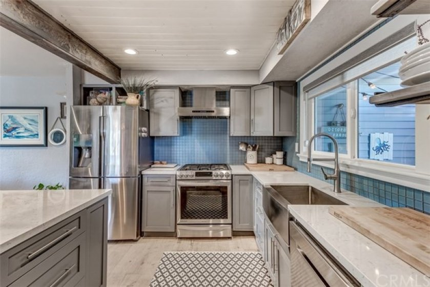 Designer kitchen - custom cabinets, new stainless appliances, and quartz counters