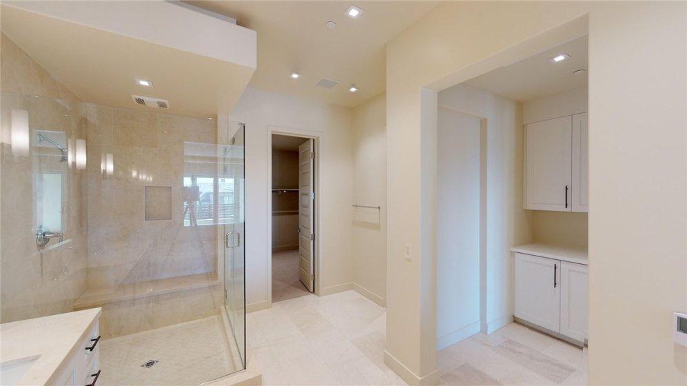 Master shower, walk in closet, linen storage.